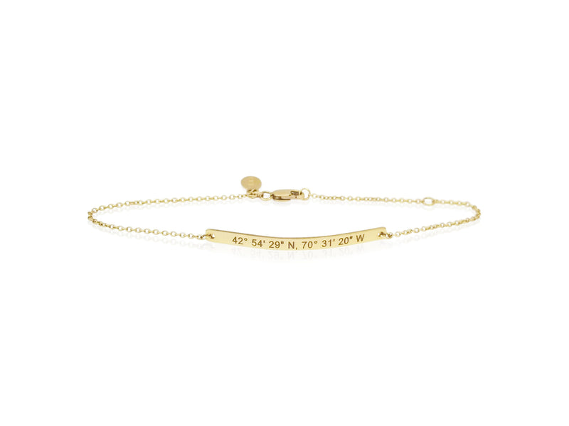 dainty coordinates bar bracelet by Lat & Lo in 14k gold-filled on model's wrist