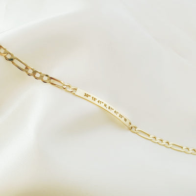Lat & Lo Co-Captains bracelet laying flat, women's style, figaro chain, engraved with coordinates, gold vermeil