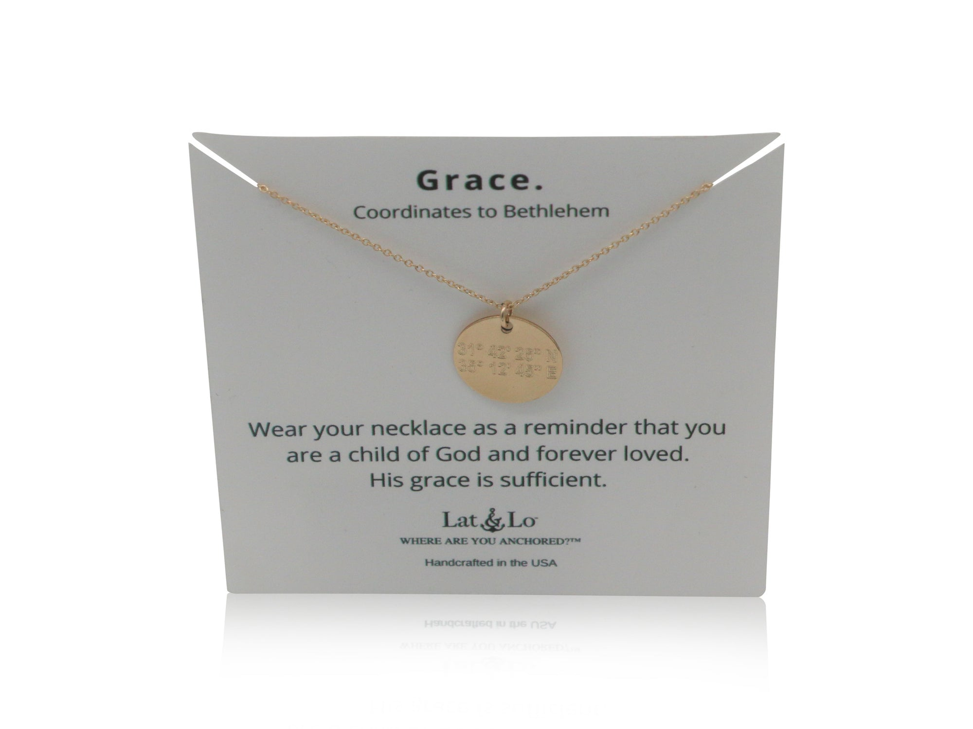 Lat & Lo Disc Necklace on a Grace display card, coordinates inscribed lead to Bethlehem, 14K gold filled