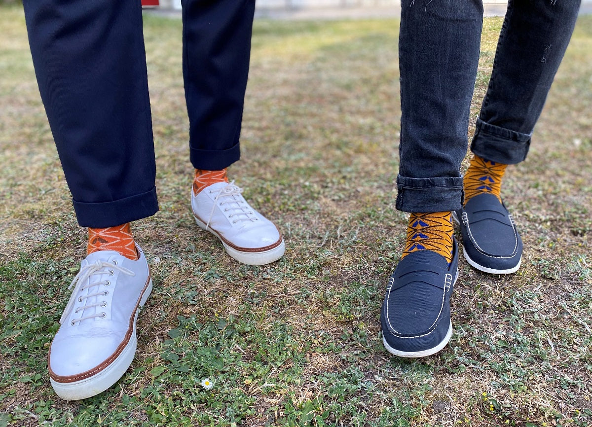 Two men in african pattern dress socks with sneakers