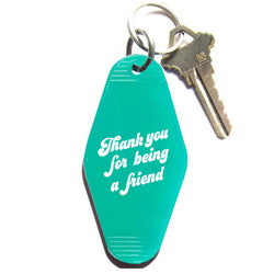 Translucent green key tag from three potato four
