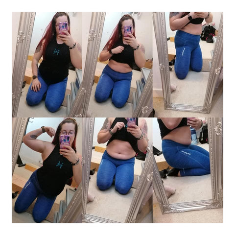Woman Wearing Black Top & Blue Leggings Showing Her Body In The Mirror