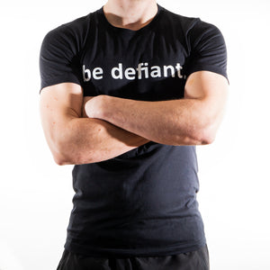 Man Wearing Be Defiant Black Essential T-Shirt Front