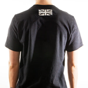 Man Wearing Be Defiant Black Essential T-Shirt Rear