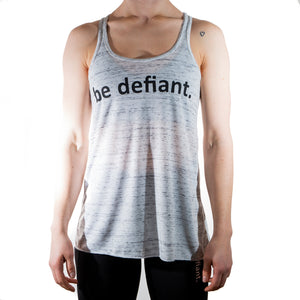 Woman Wearing Be Defiant Vest In Black Marble Front