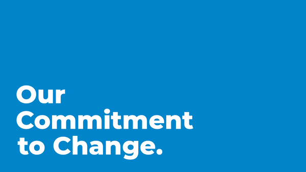 "Sphero blue graphic with ""Our Commitment to Change"" in white letters."