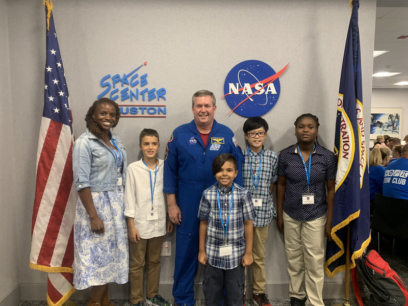 Students posing for picture with NASA astronaut.