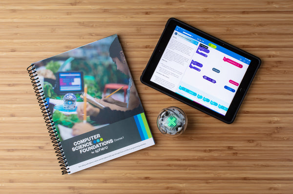 Computer Science Foundations Course 1 book with a Sphero BOLT and tablet on a desk.