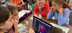 Group of students working together on littleBits products.