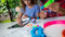 A girl and her mom work on STEAM-based activities with Sphero Mini Activity Kit at a table at home.