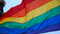 LGBTQ flag flowing in the wind.