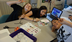 Student pose for picture while working together on littleBits.