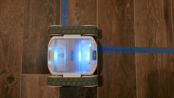 Sphero RVR navigating a tape maze on the floor of a house.