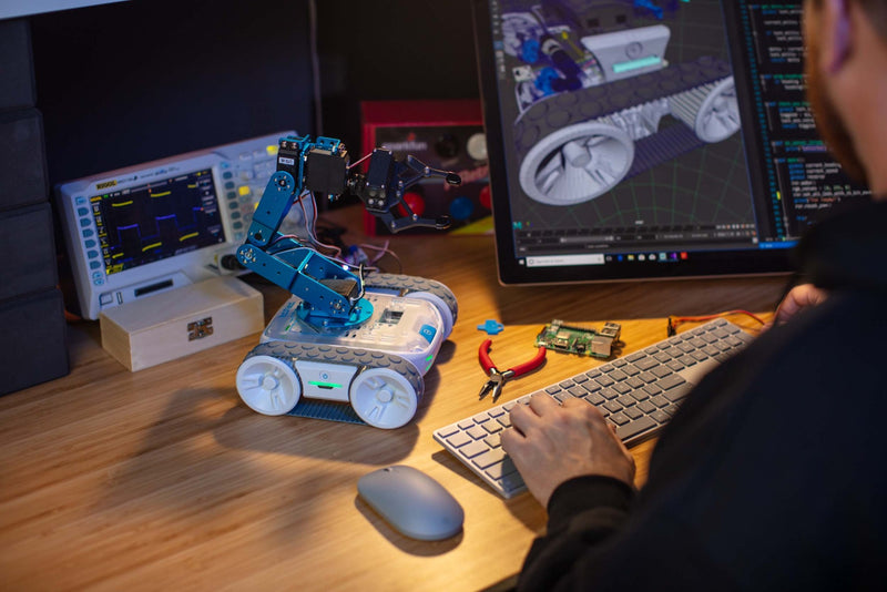 Hacker working on programming Sphero RVR using 3D model.