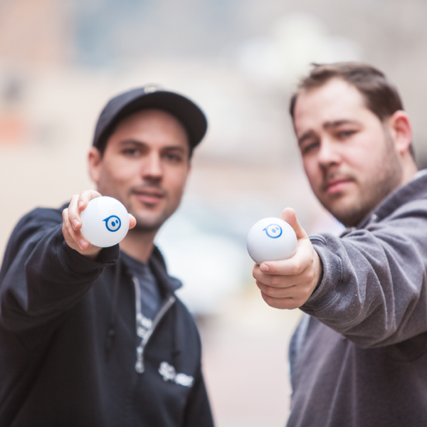 Sphero founders holing original Sphero robot toy.