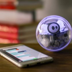 Sphero SPRK sitting by smartphone with Sphero Edu app displayed.