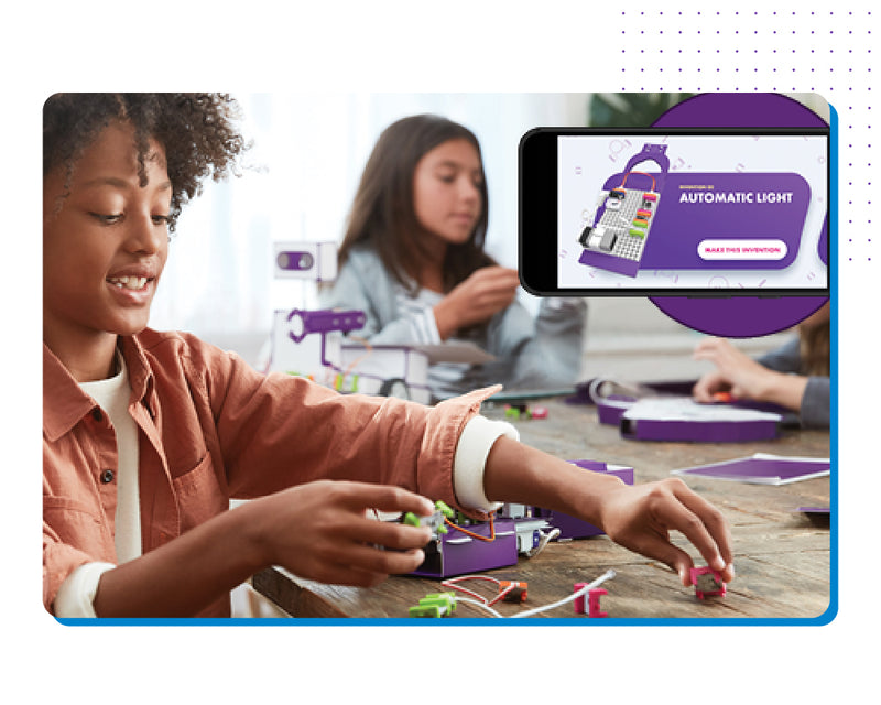 Two girls having fun learning STEAM with littleBits inventions.
