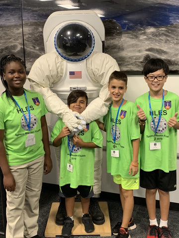 Students posing with astronauts at Sphero Space Mission