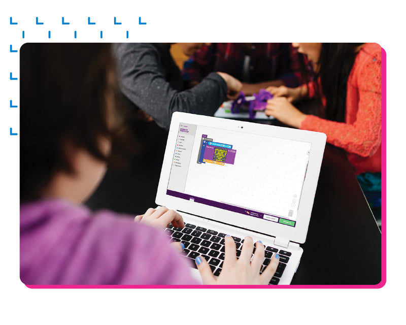 A girl on a laptop using littleBit's classroom to design a matrix.