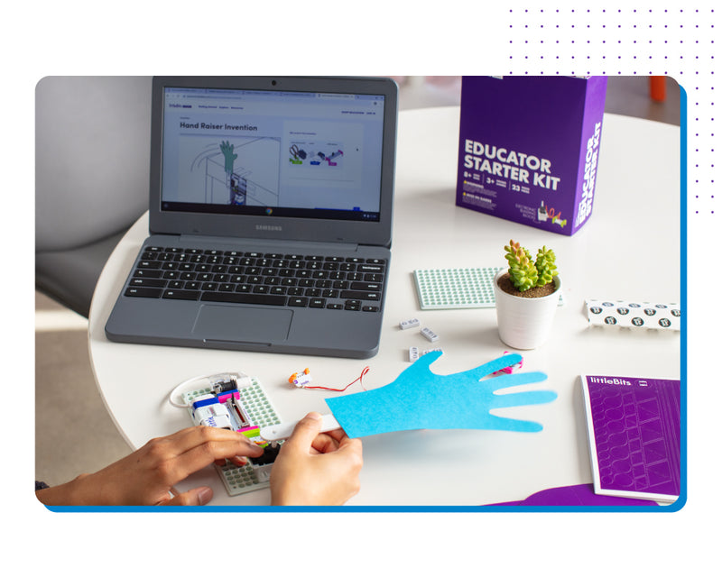 Person making hand invention with instructions on laptop.