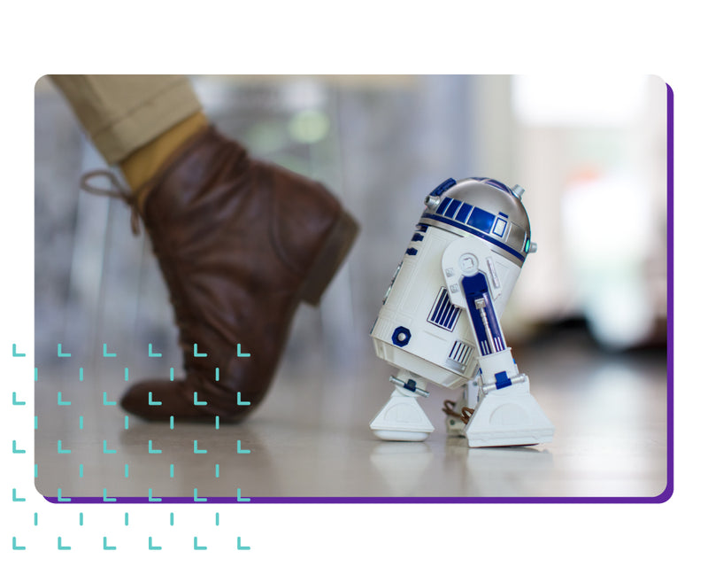 Sphero Star Wars R2-D2 toy robot following someone's footsteps.