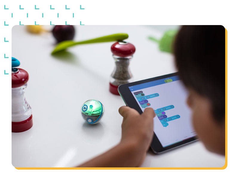Student coding STEAM mini robot through salt and pepper grinder