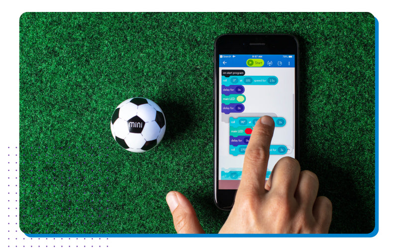 Mini Soccer next to hand coding on an iphone.