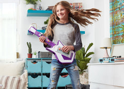 Girl having fun playing with electronic music guitar.