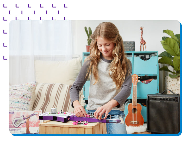 Girl creating keytar invention.