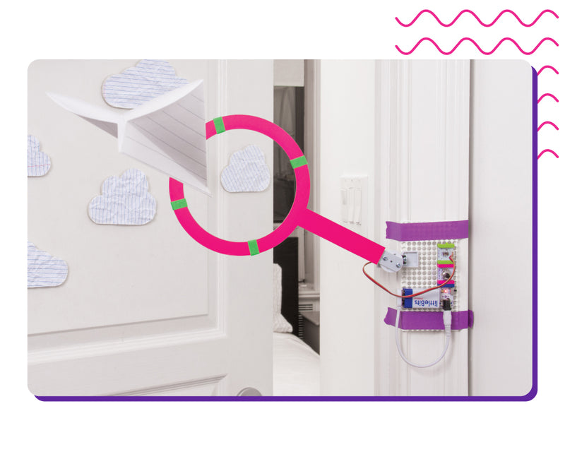 littleBits invention in front of door.
