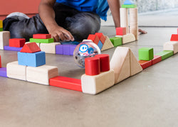 A toy robot ball in a maze built out of blocks.