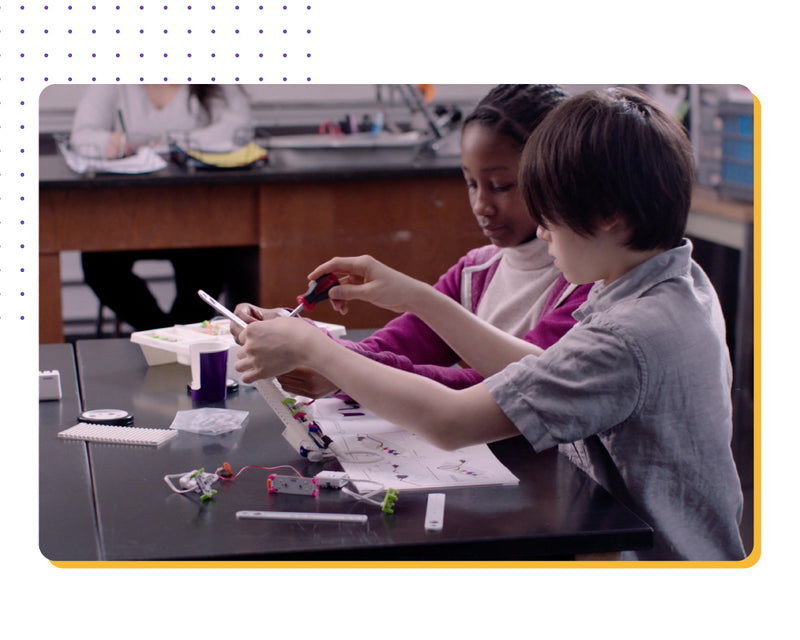 Two students working together to create littleBits STEAM Student Set invention.