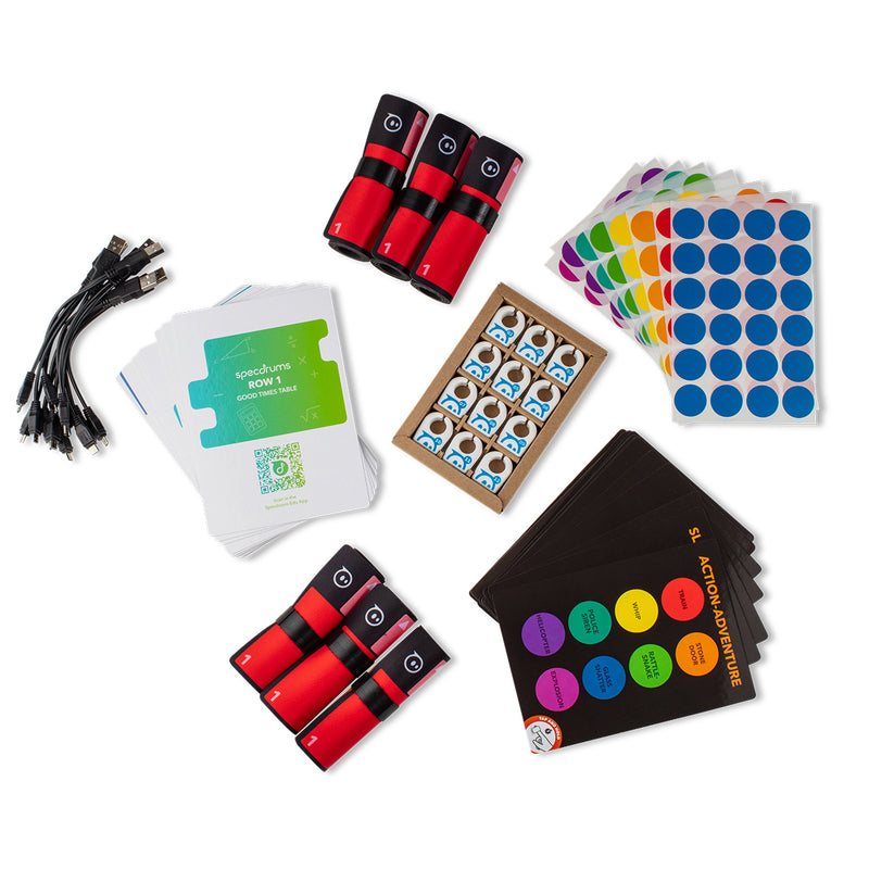Twelve Specdrums rings, activity cards, six play pads, color stickers, and USB cables.