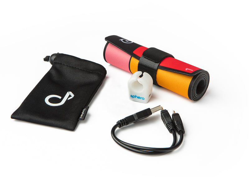 Specdrums ring, Play pad, USB charging cable, and carrying bag.