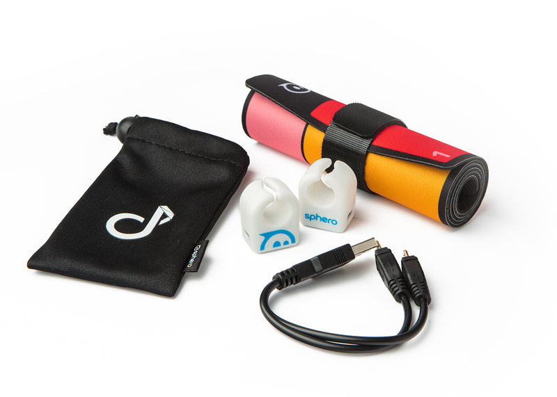 Two Specdrums rings, Play pad, USB charging cable, and carrying bag.