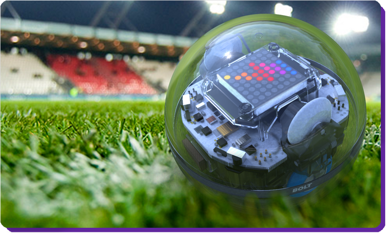A Sphero toy robot ball on a sports field.