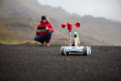 Man playing with Sphero RVR robot with anemometer science activity.
