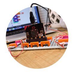 littleBits micro:bit invention in front of a laptop.