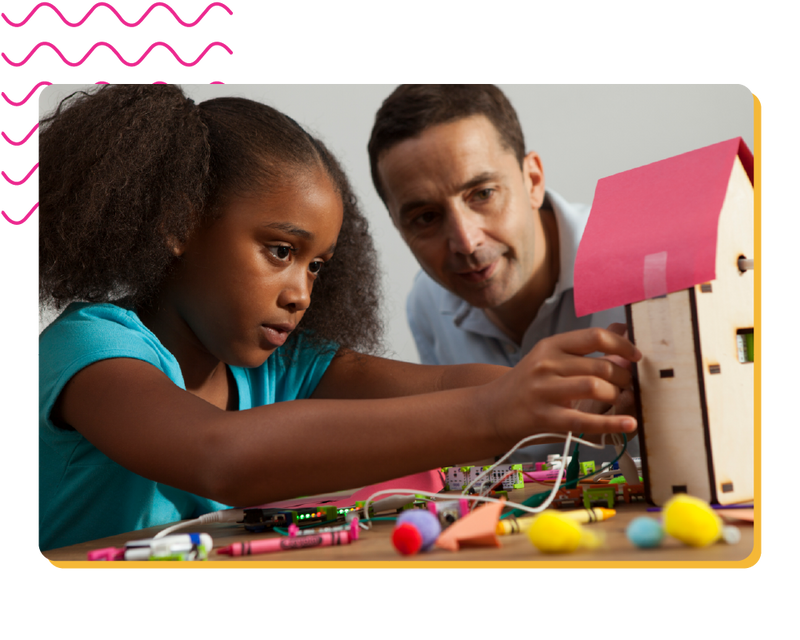 Father and daughter making a small house with littleBits