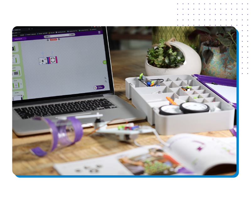 Box of littleBits next to a laptop on a desk.