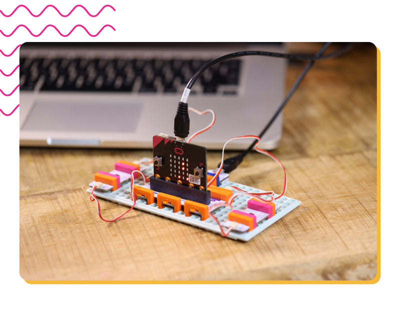 micro:bit invention with laptop in the background.