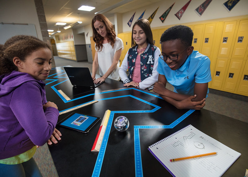 Students and teacher working with Sphero Edu Maze Tape.
