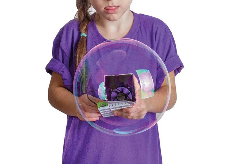 Young girl playing with STEM bubble bot.