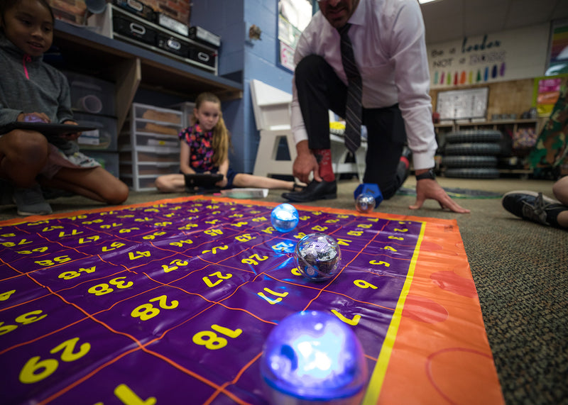 Teacher and students learning STEM while playing with Sphero BOLT.