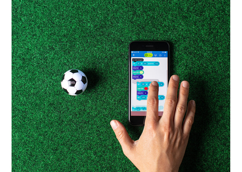 Mini Soccer being coded with an iphone.