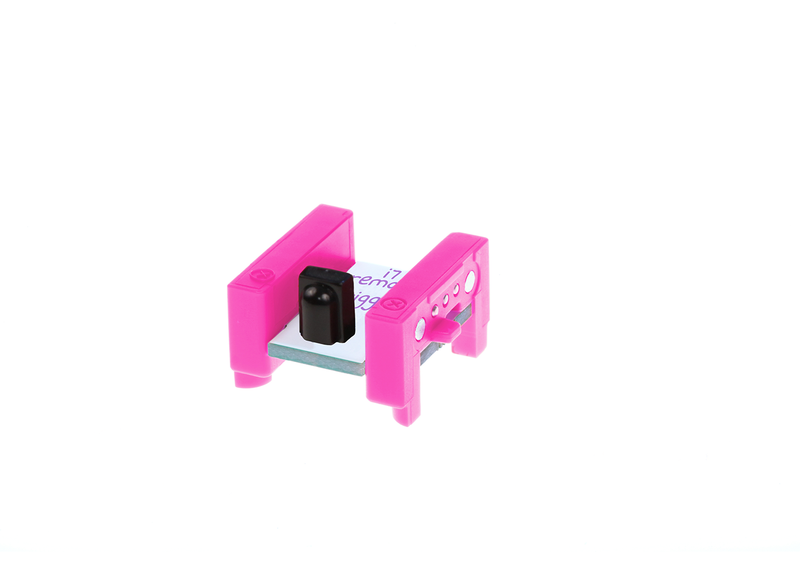 Pink littleBits i7 remote trigger bit side view.