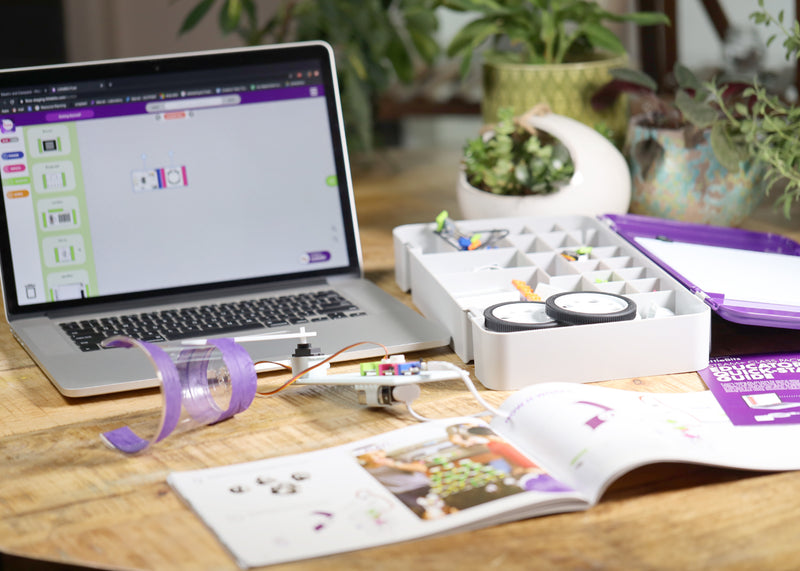 Laptop showing circuit simulator next to littleBits invention, tackle box, and invention guide.
