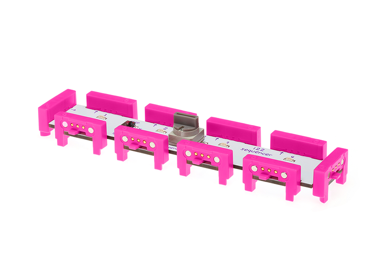 Pink littleBits i22 sequencer bit side view.
