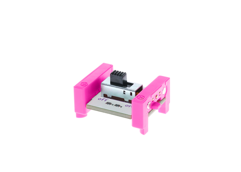 Pink littleBits i1 slide switch bit side view.