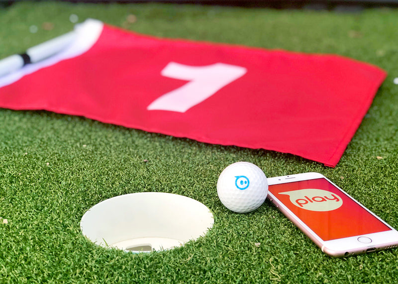 Sphero mini golf with phone and golf flag next to a golf hole.